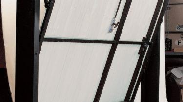 Portes de garage porte basculante 2 contrepoids for Fenetre basculante pvc